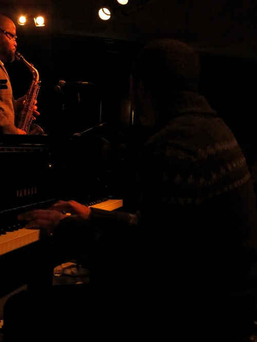 Sullivan's hands tickling the ivories
