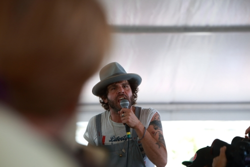 Langhorne Slim on a chair in the audience