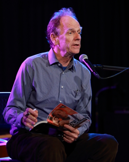 Livingston Taylor signing his book for a devoted fan
